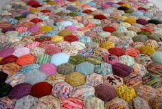 I LOVE this knitted quilt, made from little scraps of yarn. by jeannie