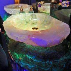 Moon stone sink and malachite countertops.