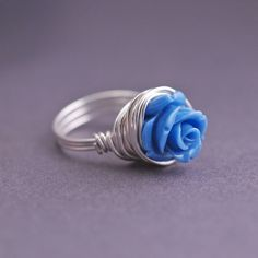 Blue Rose Ring, Sterling Silver Flower Ring, Cornflower Blue Rose Wire Wrapped Ring, Unique Ring by georgiedesigns on Etsy https://www.etsy.com/listing/125024452/blue-rose-ring-sterling-silver-flower
