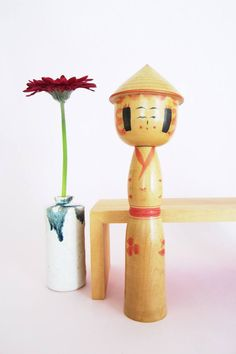 Vintage kokeshi doll with hat, available on folkeshi.com!