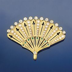 A late 19th/early 20th century gold, diamond, emerald and half-pearl brooch/pendant