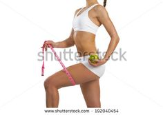 image of a young athletic woman with measuring tape and green apple