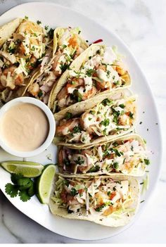 Easy Spicy Shrimp Tacos : Easy, healthy and, most importantly FABULOUS Shrimp Tacos! With cabbage and radish slaw for crunch and creamy, spicy Shrimp Taco Sauce! Shrimp Taco Sauce, Shrimp Taco Recipes, Mexican Food Recipes, Seared Salmon Recipes, Pan Seared Salmon, Healthy Shrimp Tacos, Sauce Pizza, Clean Eating, Cooking Recipes