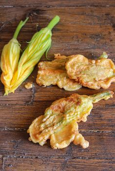 One of the best summer appetizers, a taste of Italy, stuffed zucchini flowers. A must try recipe. With prosciutto and mozzarella.