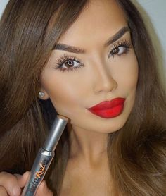 Long lashes and a statement red lip on @iluvsarahii