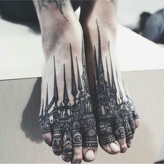 Black foot tattoo