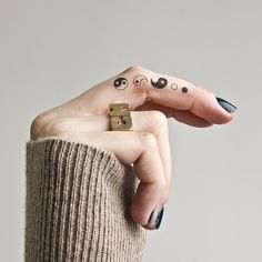 Yin Yang deconstruction temporary tattoo on the right middle finger. >>> Buy here