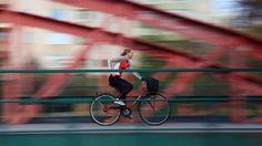 Woman cyclist on bridge Uppsala Sweden by Tonyfoster, via Flickr