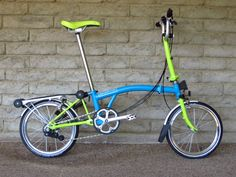 PortaPedal is selling one of the most cheerful Brompton color combos (lagoon blue with lime green extremities — including the saddle)