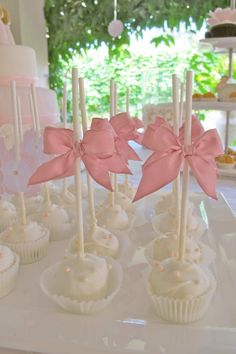 White iced cakepops with pink satin bow! Perfect for bridal/ baby shower! Cute <3