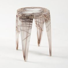 Patterns of woven natural fibres emerge from this milky resin furniture by Design Academy Eindhoven graduate Wiktoria Szawiel