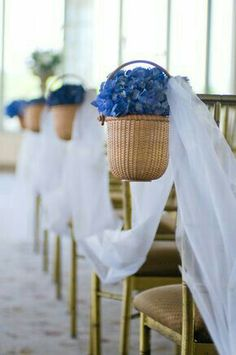 Nantucket baskets filled with blue hydrangeas