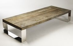 cocktail table from Greige- i love the mix of stainless legs & wood top <3