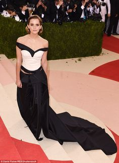 Monochrome maven: Emma Watson showcased her quirky sense of style once more in a showstopping off-the-shoulder corset at the star-studded Met Gala in New York on Tuesday
