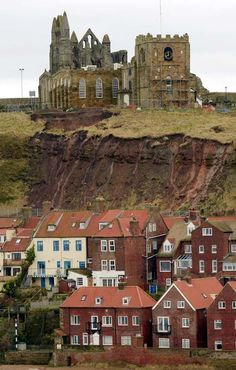 """Landslide at 'Dracula' churchyard.The exposed cliff below St Mary's Church in Whitby,North Yorkshire,England. Whitby featured in Bram Stoker's classic novel """"Dracula""""."""