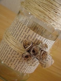 mason jar candle holders book pages   wrapped 2 book pages around the jar then added lots of sisal i made ...