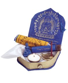 Compact box depicting the Medicine Buddha contains everything you need for proper meditation including incense, prayer flags and votive.