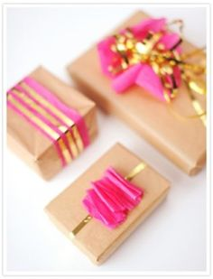 metallic ribbon and bright tissue paper on kraft paper