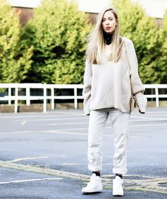 14 Creative New Ways to Wear Your Sweaters via @WhoWhatWear