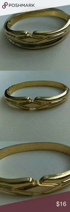 Lovely locking gold bracelet Elegant simplicity gold tone bracelet. Diamond signet design on front. Side opens to get on your wrist, and locks securely. Dress up or dress down. Perfect with jeans, office wear, or a night on the town. Bundle for a private offer. Jewelry Bracelets