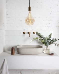 Industrial bathroom sink with concrete and white
