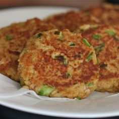 Old Bay Salmon Cakes Yield: 6-8 patties Serve with a squeeze of lemon alongside a green salad for a light and refreshing meal. Ingredients 2 6oz cans wild salmon 2 teaspoons Old Bay seasoning 2 eggs 2 tablespoons mayonnaise 3/4 cup panko 1 small green pepper, finely chopped 2 tablespoons chopped fresh chives light olive oil for frying