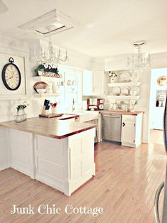 White kitchen at Junk Chic Cottage-I like the clock inside of the frame