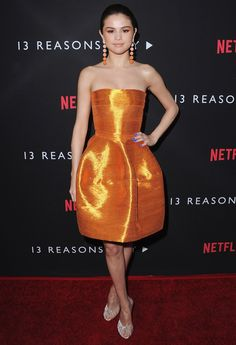 Sometimes making a statement is all about amplifying one element. At the premiere of 13 Reasons Why, Selena Gomez stunned by going monochromatic in a bold orange hue.