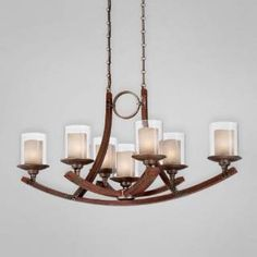 Check out the Eurofase 25643-015 Mano 7 Light Oval Chandelier in Wood/Forged Iron
