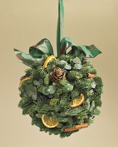 the Season: 10 Holiday Decor Ideas Evergreen Orange Kissing Ball from Williams SonomaEvergreen Orange Kissing Ball from Williams Sonoma Christmas Flowers, Christmas Balls, Rustic Christmas, All Things Christmas, White Christmas, Christmas Holidays, Christmas Wreaths, Christmas Decorations, Christmas Ornaments