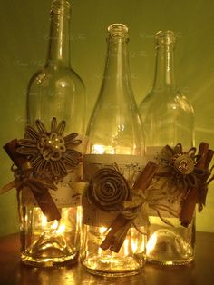 decorated Christmas bottles (view 1) - sheet music, cinnamon sticks, ribbon…