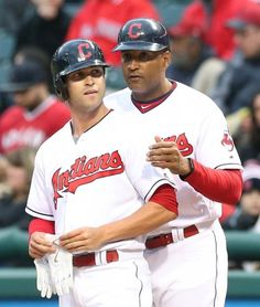 Cleveland Indians rookie Tyler Naquin talks with first base coach Sandy Alomar Jr. after Naquin got his first major league hit in the 2nd inning against the Boston Red Sox at Progressive Field on April 6, 2016.   (Chuck Crow/The Plain Dealer)