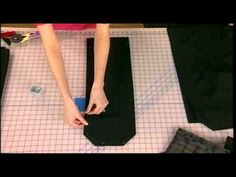 Tablet cover - video tutorial  (You need to watch the first part of the video to see it, but it uses grommets on the back to string through a strap that wraps around and ties.  Closure flap just tucks into the wrapped around ties.)