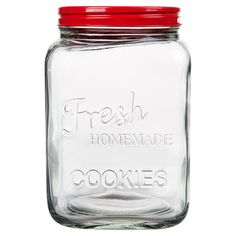 Stow chocolate chip treats or fresh biscotti in this charming glass cookie jar, showcasing a textured typographic motif and red lid.