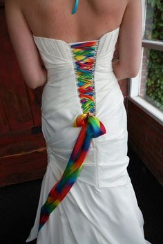 "Wedding Themes Rainbow ribbon back of dress - Offbeat Bride reader Katie said that she never thought she'd have a white dress. So, she explained, ""I really colored it up with my accessories!"" Including this awesome shock of r… White Wedding Gowns, Wedding Dresses, Rainbow Wedding Dress, Anne Laure, Rainbow Ribbon, Rainbow Colors, Rainbow Laces, Rainbow Theme, Dream Wedding"
