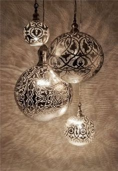 Spray paint a crystal or clear ornament.  They overlayed it with a doily and used silver spray paint to get the beautiful design.  Any metallic spray paint would be awesome!