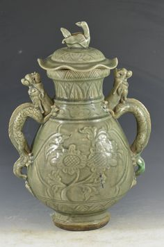 Chinese Celadon Glazed Porcelain Lidded Vase with Bird Finial on Lid Top and Mythical Dragon/Beast Handles. (With Lid) H: 15.6 Inches