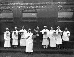 New exhibit opening January 15, 2012 at the Oregon Historical Society, on Railroading and Portland's Black Community.  This image shows waiters posing in front of the Northern Pacific's Spokane-Portland-Seattle run in 1915. William H. Rutherford (far right) was recruited by the Portland Hotel from Columbia, South Carolina in 1897. (Courtesy of the Oregon Historical Society, bb004688)