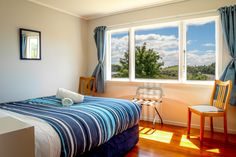 Holiday House | Russell- Orongo Bay Holiday Park.  Master Bedroom situated in the holiday house.