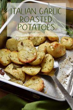 Crispy Italian Oven Roasted Garlic Potatoes || Crispy Italian Oven Roasted Garlic Potatoes recipe #Vegetarianrecipe #potatoes #garlicpotatoes #side #crispypotatoes #roastedgarlicpotatoes #vegan #italian #thanksgiving #thanksgivingside #thanksgivingrecipes #holidays #roastedpotatorecipe #roastedpotatoes via @Loves_biscotti