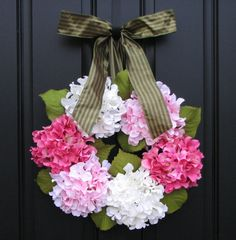 """Spring Wreath with white, light pink and a dark pink hydrangeas, resting on a 14"""" grapevine wreath. Perfect for Spring."""
