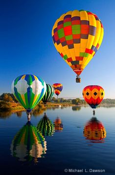 Hot-Air Balloons reflect in the still waters of the Yakima River near Prosser, Wa