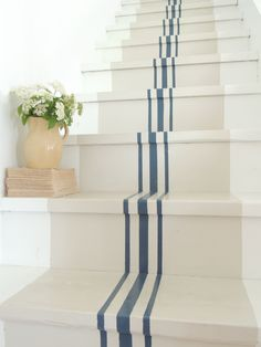 Add grain sack inspired stripes to your staircase to make the space more fun and interesting. It's an easy way to instantly add some crafty DIY flair to your home.