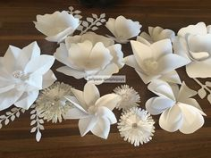 The flower backdrop is coming together nicely. I have been making different shapes and sizes of paper flowers.