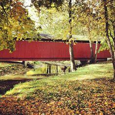 Red covered bridge in Highland Park.  #kokomo #indiana Photo by @kmdenta.
