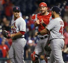 A.J. Pierzynski high-fives with Tony Cruz and Trevor Rosenthal after the Cards defeated the Phillies 6-5 in twelve innings. 8-23-14