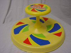 Sit and Spin. I could spin on this for hours! One of my favorite toys as a child. I was so sad when I out grew it.