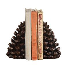 When it comes to inspiring home décor, we like to look at the great outdoors. These woodsy bookends remind us yet again that nature truly knows best. For holding up your beloved collection of art books...  Find the Rustic Pinecone Bookends, as seen in the Cabin In the Redwoods Collection at http://dotandbo.com/collections/cabin-in-the-redwoods?utm_source=pinterest&utm_medium=organic&db_sku=CCO0137