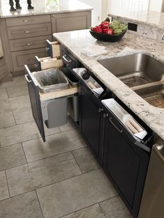 #Diamond Wastebasket and Tilt Out Drawers: Tilt out drawers are nice to store a sponge or drop rings into while doing dishes, making use of false drawer fronts. And wastebasket keeps your trash out of site but easily accessible. #DiamondStorageSolutions