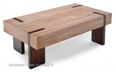 A linear approach and a generously over-sized top design give our wood block coffee table a modern rustic appeal. Four stainless steel legs (brushed or polished finish) offer contrast and stability to this large design, while the warm rich wood tones lend a rustic sensibility that is sure to enhance any room. This contemporary wood